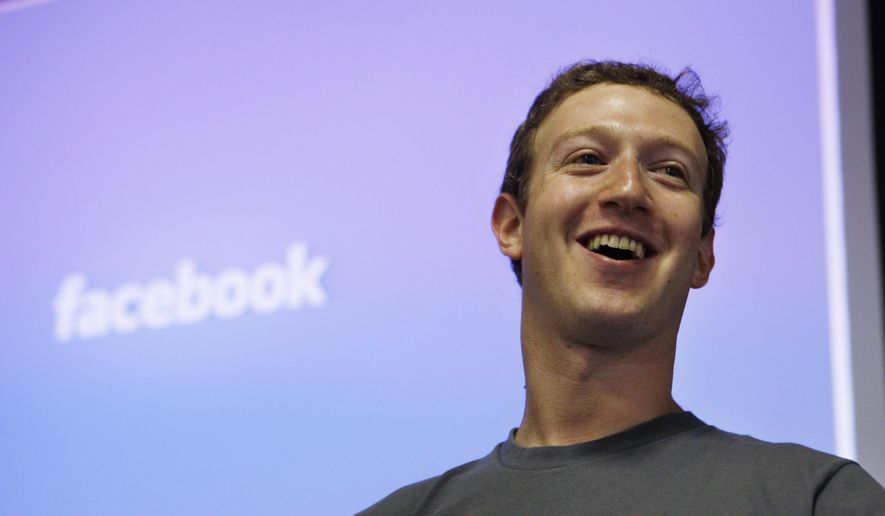 Facebook CEO Mark Zuckerberg smiles during an announcement at Facebook headquarters in Palo Alto, Calif., in this July 6, 2011, file photo. (AP Photo/Paul Sakuma, File)