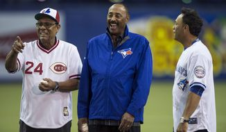 Former Cincinnati Reds player and manager Tony Perez, left, former Toronto Blue Jays manager Cito Gaston, center, and former Blue Jays' Roberto Alomar share a laugh during a ceremony before an exhibition baseball game between the Jays and the Reds Saturday, April 4, 2015, in Montreal. (AP Photo/The Canadian Press, Paul Chiasson)