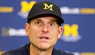 Michigan head coach Jim Harbaugh answers questions during a press conference after their spring NCAA college football game in Ann Arbor, Mich., Saturday, April 4, 2015. (AP Photo/Tony Ding)