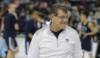 Connecticut head coach Geno Auriemma watches his team workout during a practice session for the NCAA Final Four tournament women's college basketball semifinal game, Saturday, April 4, 2015, in Tampa, Fla. Connecticut will play Maryland Saturday in a semifinal game. (AP Photo/Chris O'Meara)