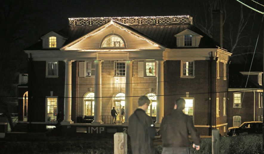 "FILE - Students participating in rush pass by the Phi Kappa Psi house at the University of Virginia in Charlottesville, Va., in this Jan. 15, 2015 file photo. Now the Columbia Graduate School of Journalism is about to explain how it all went so wrong. The school's analysis of the editorial process that led to the November 2014 publication of ""A Rape on Campus"" will be released online at 8 p.m. EDT Sunday April 5, 2015. (AP Photo/Steve Helber, File)"