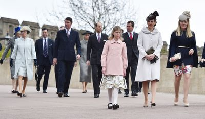 Members of the British royal family, including left to right (excluding back row) Britain's Prince Andrew, Princess Anne and her husband Timothy Laurence, Prince Edward Earl of Wessex, Lady Louise Windsor, Sophie Countess of Wessex, Autumn Philips and Princess Beatrice, arrive for the Easter Sunday church service at St George's Chapel, Windsor Castle, in Windsor, England on Sunday, April 5, 2015. (AP Photo/Ben Stansall, Pool)