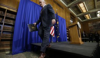 "FILE - In this March 31, 2015 file photo, Indiana Gov. Mike Pence steps off the podium after discussing the state's new religious-freedom law in Indianapolis. Tourism agencies in Indianapolis and Fort Wayne are rolling out campaigns to tout the fact that ""All Are Welcome"" in Indiana, but it might not be enough to completely heal the black eye the state received over its nationally-criticized religious objections law. (AP Photo/Darron Cummings, File)"