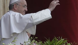 Pope Francis delivers the Urbi et Orbi (to the city and to the world) blessing at the end of the Easter Sunday Mass in St. Peter's Square at the Vatican , Sunday, April 5, 2015. (AP Photo/Alessandra Tarantino)