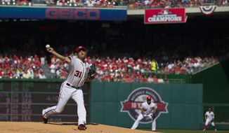 Washington Nationals starting pitcher Max Scherzer delivers his first pitch as a National against the New York Mets during the first inning of an opening day baseball game at Nationals Park on Monday, April 6, 2015, in Washington. (AP Photo/Evan Vucci)