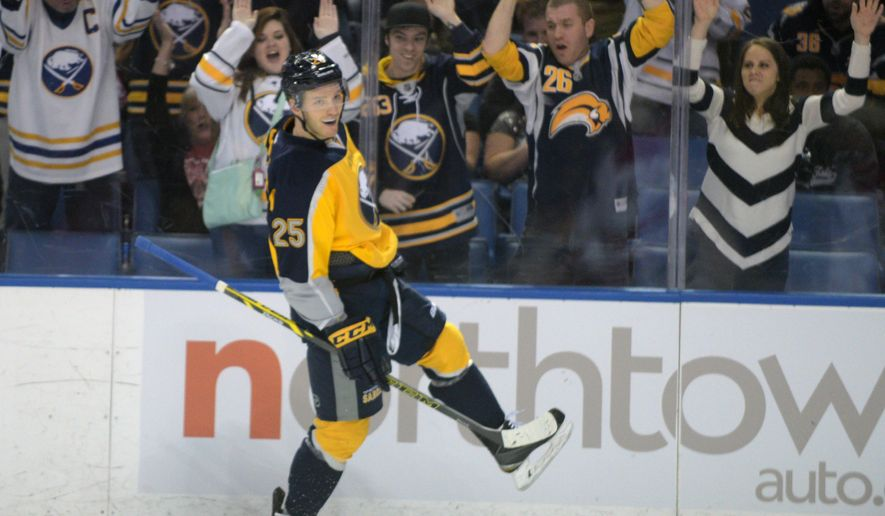 Buffalo Sabres Mikhail Grigorenko (25), of Russia, celebrates his goal in front of Sabres fans during the first period of an NHL hockey game against the Carolina Hurricanes Monday, April 6, 2015, in Buffalo, N.Y. (AP Photo/Gary Wiepert)