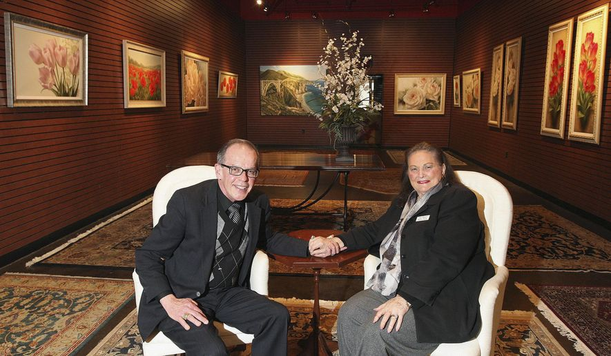 In this Feb. 23, 2015 photo, Joan Winters poses for a photo with her husband, Jerry, inside Winters Gallery at Hickory Point Mall in Decatur, Ill. The gallery, which opened March 1, showcases fine art from around the world. (AP Photo/Herald & Review, Jim Bowling)