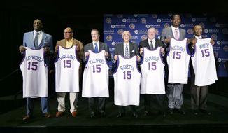 Former NBA player Spencer Haywood, from left, former college coach George Raveling, Kentucky coach John Calipari, NBA referee Dick Bavetta, former ABA player Louie Dampier, former NBA player Dikembe Mutumbo and former NBA player Jo Jo White stand on stage during the Naismith Memorial Basketball Hall of Fame class of 2015 announcement, Monday, April 6, 2015, in Indianapolis. (AP Photo/Charlie Neibergall)