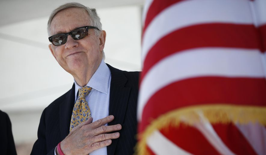 Senate Minority Leader Harry Reid, D-Nev., listens to the national anthem during a groundbreaking ceremony for the Interstate 11 Boulder City bypass project Monday, April 6, 2015, in Boulder City, Nev. (AP Photo/John Locher)
