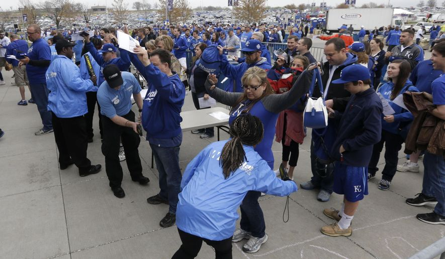 Security screens fans before an opening day baseball game between the Chicago White Sox and Kansas City Royals at Kauffman Stadium in Kansas City, Mo., Monday, April 6, 2015. (AP Photo/Orlin Wagner)
