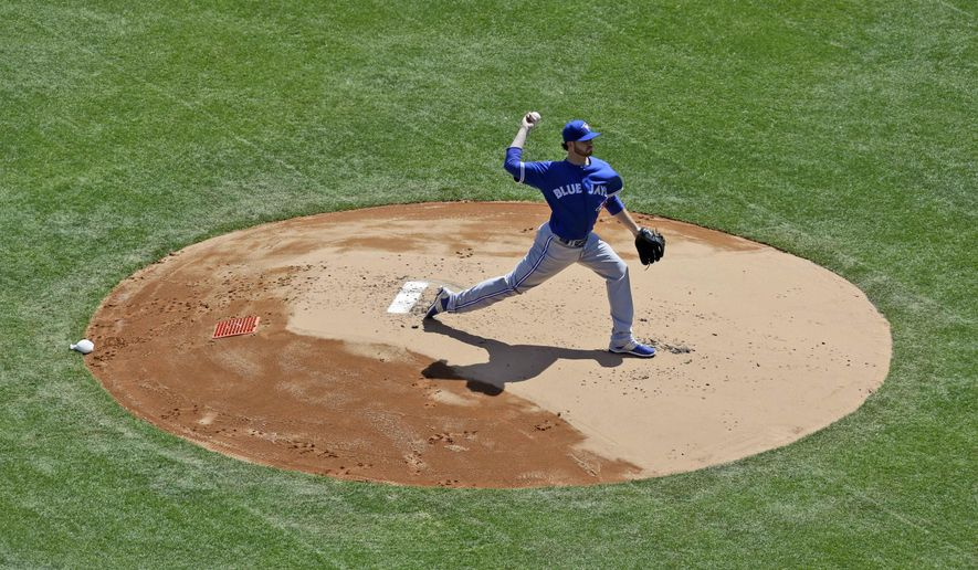 Toronto Blue Jays starting pitcher Drew Hutchison pitches during the first inning of the opening day baseball game against the New York Yankees at Yankee Stadium, Monday, April 6, 2015 in New York. (AP Photo/Seth Wenig)