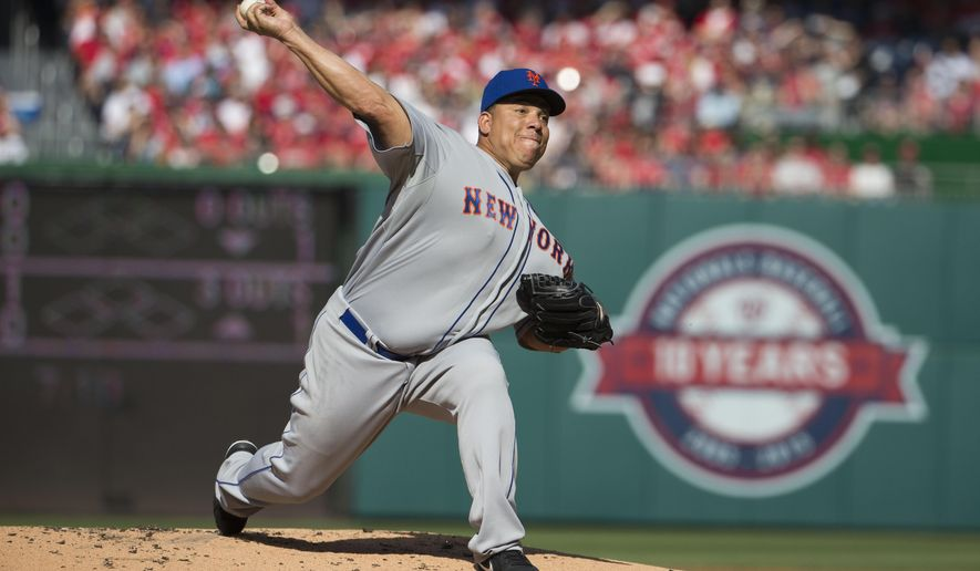 New York Mets starting pitcher Bartolo Colon delivers a pitch against the Washington Nationals during the first inning of an opening day baseball game at Nationals Park on Monday, April 6, 2015, in Washington. (AP Photo/Evan Vucci)