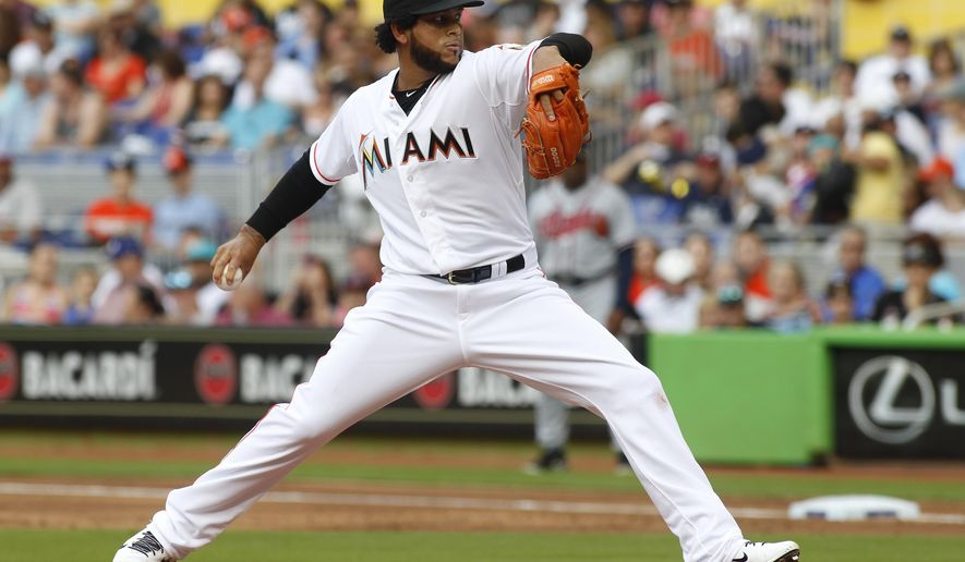 Miami Marlins starting pitcher Henderson Alvarez throws in the first inning against the Atlanta Braves during their baseball game in Miami, Monday, April 6, 2015. (AP Photo/Joe Skipper)