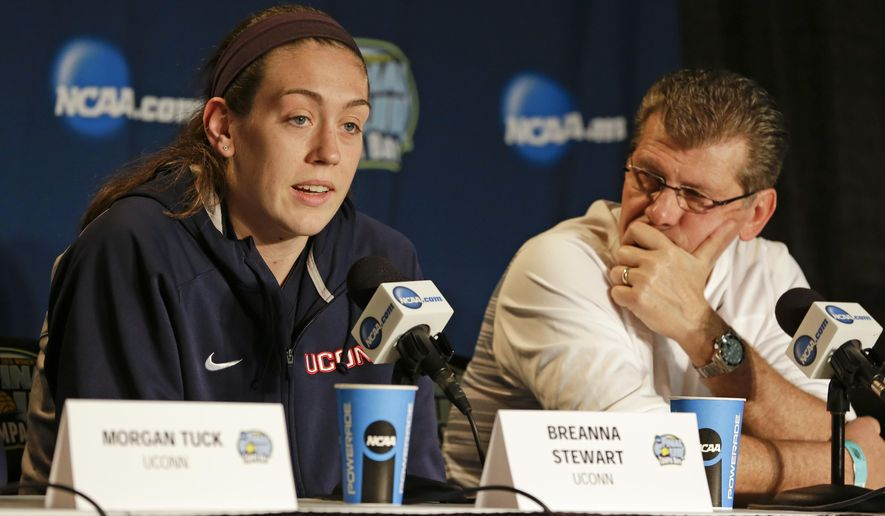 Connecticut forward Breanna Stewart, left,  answers a question as head coach Geno Auriemma listens, during a news conference at the NCAA Women's Final Four college basketball tournament, Monday, April 6, 2015, in Tampa, Fla.  Connecticut will play Notre Dame in the championship game on Tuesday. (AP Photo/John Raoux)