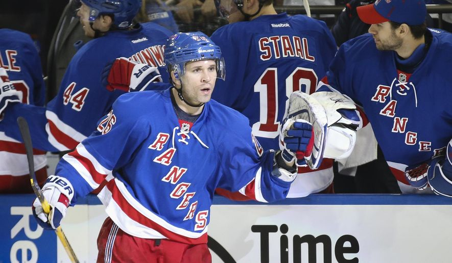 New York Rangers right wing Martin St. Louis (26) celebrates with New York Rangers goalie Cam Talbot, right, after scoring in the first period of an NHL hockey game against the Columbus Blue Jackets, Monday, April 6, 2015, in New York. (AP Photo/John Minchillo)