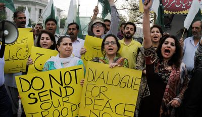 Members of Pakistan's civil society chant slogans against the Saudi-led coalition targeting Shiite rebels in Yemen in Lahore. Pakistan's defense minister confirmed a request for soldiers Monday, raising the possibility of a ground offensive (ASSOCIATED PRESS)