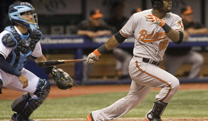 Tampa Bay Rays catcher Rene Rivera watches as Baltimore Orioles' Alejandro De Aza, right, hits a two-run home run during the fifth inning of an opening day baseball game, Monday, April 6, 2015 in St. Petersburg, Fla. (AP Photo/Steve Nesius)
