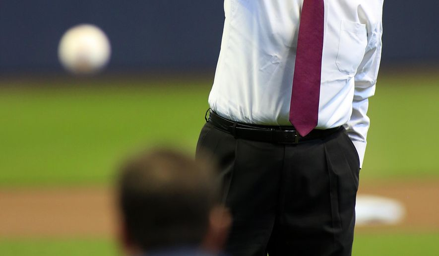 Former Major League Baseball commissioner Bud Selig throws out the first pitch before the start of an opening day baseball game between the Milwaukee Brewers and the Colorado Rockies Monday, April 6, 2015, in Milwaukee. (AP Photo/Darren Hauck)