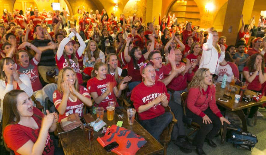 Wisconsin fans react as they watch the Wisconsin Duke game at the Rathskeller on the UW campus Monday, April 6, 2015, in Madison, Wis., during the NCAA Championship. (AP Photo/Andy Manis)