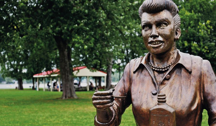 In an August 2012 photo, a bronze sculpture of Lucille Ball is displayed in Lucille Ball Memorial Park in the village of Celoron, N.Y., in her hometown. Since the sculpture was unveiled in 2009, the statue has been blasted by critics who say it bears little or no likeness to the popular 1950s sitcom actress and comedian. Village officials say they want the sculptor to fix it for free, but the artist wants as much as $10,000 to alter the statue. The village has started a fundraising effort to pay for the sculpture's makeover. (AP Photo/The Post-Journal)  BUFFALO OUT