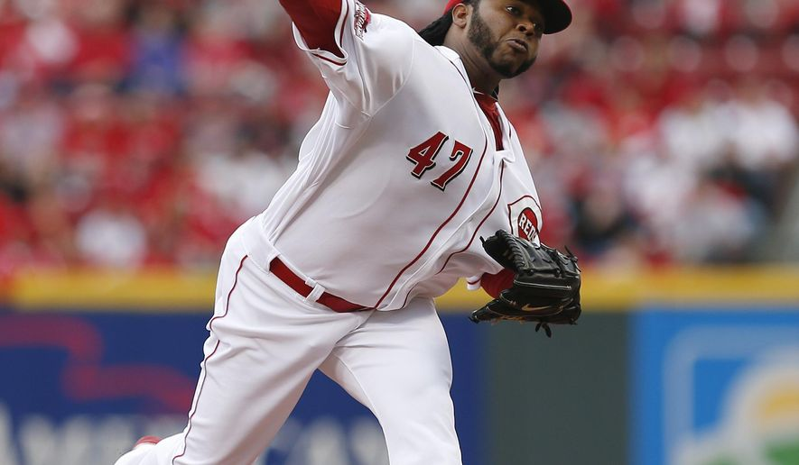 Cincinnati Reds' starting pitcher Johnny Cueto throws against the Pittsburgh Pirates during the first inning of an opening day baseball game Monday, April 6, 2015, in Cincinnati. (AP Photo/Gary Landers)