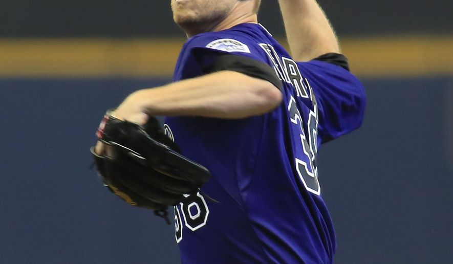 Colorado Rockies pitcher Kyle Kendrick pitches to the Milwaukee Brewers during the first inning of a baseball game Monday, April 6, 2015, in Milwaukee. (AP Photo/Darren Hauck)