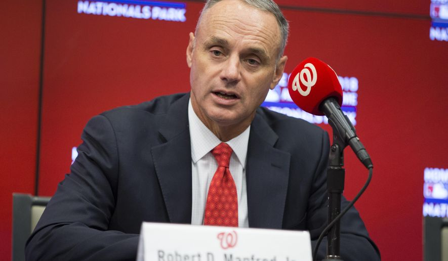 Major League Baseball commissioner Rob Manfred speaks during a news conference before an opening day baseball game between the New York Mets and Washington Nationals at Nationals Park on Monday, April 6, 2015, in Washington. Manfred announced that Nationals Park will host the 2018 All-Star Game. (AP Photo/Evan Vucci)