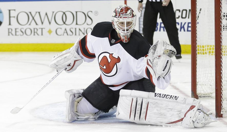 New Jersey Devils goalie Keith Kinkaid (1) stops a shot on the goal during the second period of an NHL hockey game against the New York Rangers Saturday, April 4, 2015, in New York. (AP Photo/Frank Franklin II)