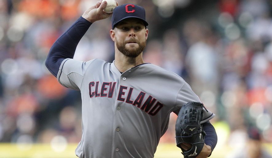 Cleveland Indians' pitcher Corey Kluber throws during the first inning of an opening day baseball game against the Houston Astros, Monday, April 6, 2015, in Houston. (AP Photo/Patric Schneider)