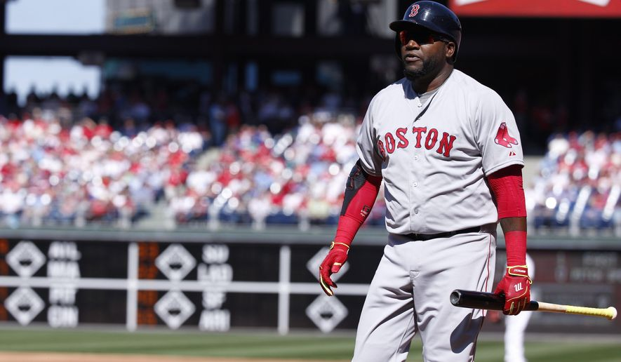 Boston Red Sox designated hitter David Ortiz heads back to the dugout after striking out during the first inning of an opening day baseball game against the Philadelphia Phillies, Monday, April 6, 2015, in Philadelphia. (AP Photo/Chris Szagola)
