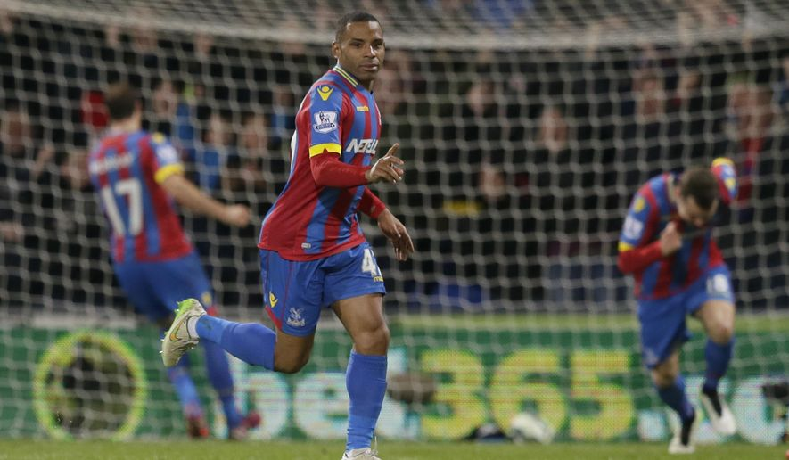 Crystal Palace's Jason Puncheon celebrates after scoring a goal during the English Premier League soccer match between Crystal Palace and Manchester City at Selhurst Park Stadium, London, Monday, April 6, 2015. (AP Photo/Tim Ireland)