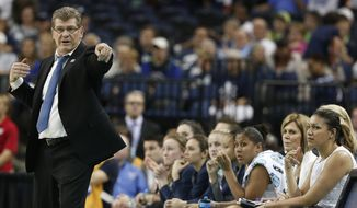 Connecticut head coach Geno Auriemma speaks to an official during the second half of the NCAA Women's Final Four tournament college basketball semifinal game against Maryland, Sunday, April 5, 2015, in Tampa, Fla. (AP Photo/Brynn Anderson )