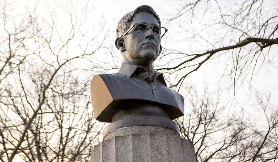 This photo provided by Aymann Ismail/ANIMALNewYork on Monday, April 6, 2015, shows an installation of a bust of the former National Security Agency contractor Edward Snowden in Brooklyn's Fort Greene Park, in New York. After several mysterious artists put a sculpted bust of Snowden on a New York City war memorial, parks officials have ordered the bust removed. Animal New York, a city news website, reported that the activists sneaked the 4-foot-tall, 100-pound bust of Snowden before dawn Monday. (AP Photo/Aymann Ismail/ANIMALNewYork)