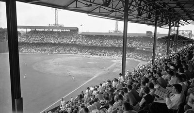 Griffith Stadium is packed with fans on hand for the 23rd All-Star major league baseball game in Washington, July 10, 1956. This view is from the left field corner of the double deck stands shortly before game time. (AP Photo)