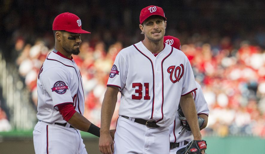 Washington Nationals starting pitcher Max Scherzer, right, reacts as manager Matt Williams walks to the mound to pull him from the game during the eighth inning of an opening day baseball game against the New York Mets at Nationals Park on Monday, April 6, 2015, in Washington. The Mets defeated the Nationals 3-1. At left is shortstop Ian Desmond. (AP Photo/Evan Vucci)