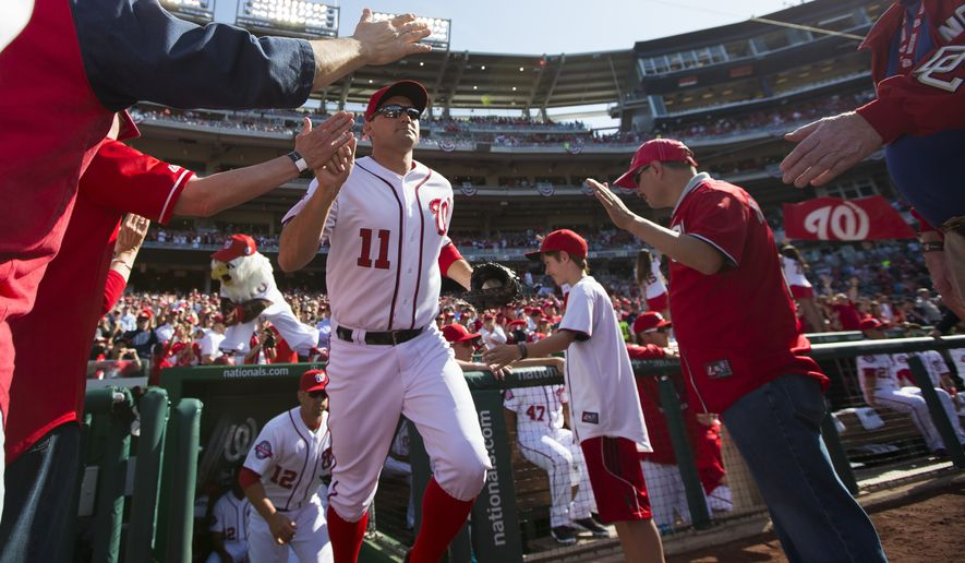 Washington Nationals Ryan Zimmerman takes the field before the start of an opening day baseball game against the New York Mets at Nationals Park on Monday, April 6, 2015, in Washington. (AP Photo/Evan Vucci)