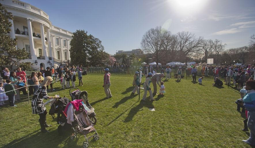 Children participate in the White House Easter Egg Roll on the South Lawn of White House in Washington, Monday, April 6, 2015. Thousands of children gathered at the White House for the annual Easter Egg Roll. This year's event features live music, cooking stations, storytelling, and of course, some Easter egg roll. (AP Photo/Pablo Martinez Monsivais)