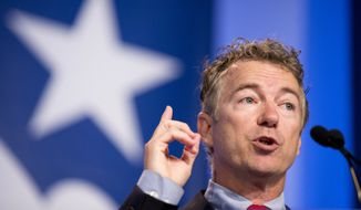 Sen. Rand Paul, Kentucky Republican, is set to follow in the footsteps of his father, former Rep. Ron Paul, in making a White House bid. (Associated Press)