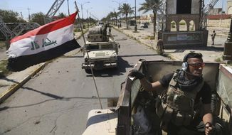 Iraqi security forces deploy in Tikrit, 80 miles (130 kilometers) north of Baghdad, Iraq, a day after Iraqi security forces backed by Shiite militiamen took control of the city from Islamic State militants in this Thursday, April 2, 2015, file photo. (AP Photo/Khalid Mohammed, File)