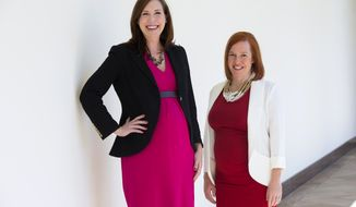 In this photo taken April 1, 2015, Jen Psaki, right, and Katie Fallon, pose at the White House in Washington. Communications director Jen Psaki and legislative affairs director Katie Beirne Fallon say President Obama has pledged to support them as they start their families while working on his senior team. Ms. Psaki is expecting a daughter in July and Ms. Fallon is scheduled to give birth to identical twin boys in May.  (AP Photo/Evan Vucci)