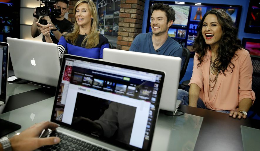 "In this March 31, 2015 photo, seated from left, co-hosts Beth Troutman, Oli Pettigrew and Christian Vera film a segment on the set of ""Right This Minute"", in Phoenix. The show gives viewers a daily dose of web videos and the stories behind them. (AP Photo/Matt York)"