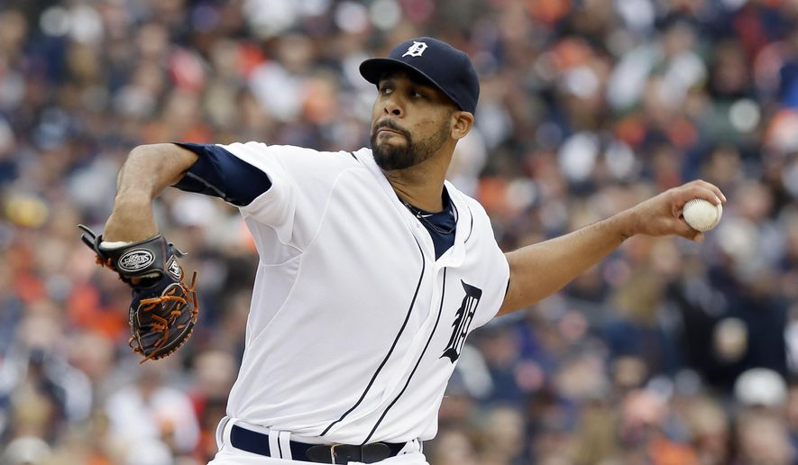 Detroit Tigers starting pitcher David Price throws during the first inning of an opening day baseball game against the Minnesota Twins in Detroit, Monday, April 6, 2015. (AP Photo/Carlos Osorio)