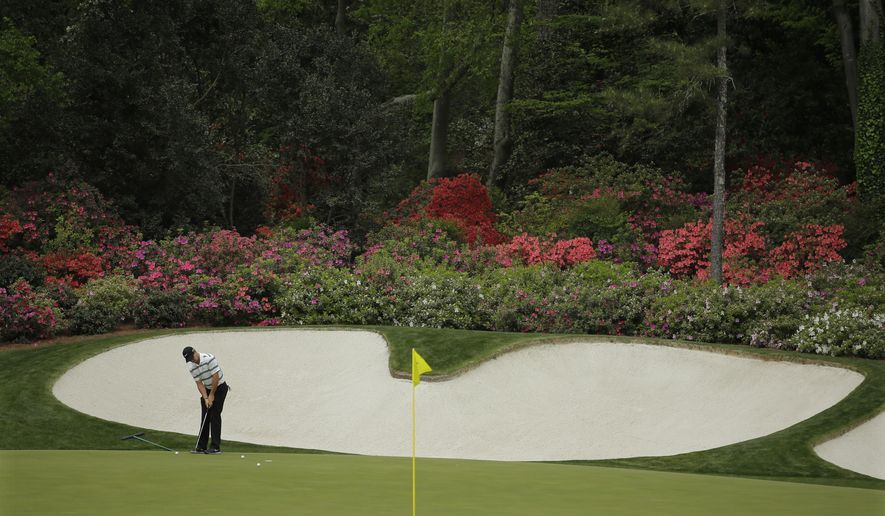 Rory McIlroy, of Northern Ireland,  putts on the 13th green during a practice round for the Masters golf tournament Monday, April 6, 2015, in Augusta, Ga. (AP Photo/Matt Slocum)