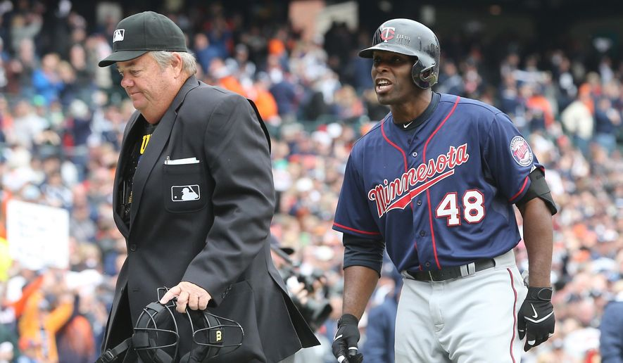 Minnesota Twins' Torii Hunter argues his strike three call with home plate umpire Joe West that ended the game in the ninth inning of an opening day baseball game against the Detroit Tigers in Detroit, Monday, April 6, 2015. The Tigers defeated the Twins 4-0. (AP Photo/Carlos Osorio)