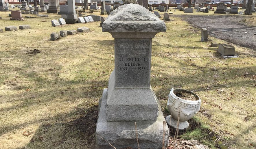 This April 1, 2015 photo shows the headstone for Stephanie Boller's grave in Beaver Cemetery. The then 5-year-old  Boller went missing from her Beaver Falls, Pa. home on Jan. 8, 1977. On Nov. 6 of that year, men walking through Bradys Run Park spotted what appeared to be human remains. Police determined the men had found Stephanie. She had been hit in the head and apparently died from a skull fracture. The case remains unsolved. (AP Photo/Beaver County Times, Gwen Titley)