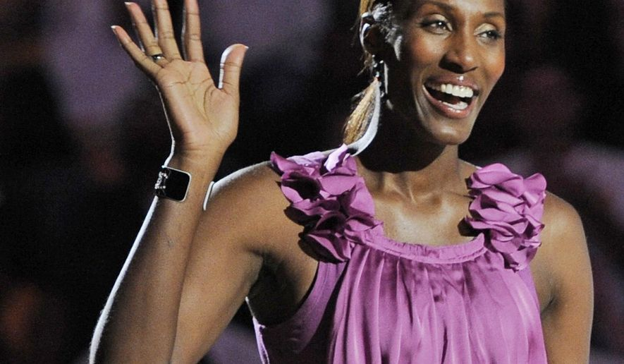 FILE - This Aug. 10, 2010, file photo shows retired Los Angeles Sparks basketball player Lisa Leslie waving to the crowd during a ceremony to retire her jersey at halftime of a WNBA basketball game between the Indiana Fever and the Sparks in Los Angeles. Lisa Leslie was selected to the Naismith Hall of Fame, Monday, April 6, 2015. (AP Photo/Chris Pizzello, File)