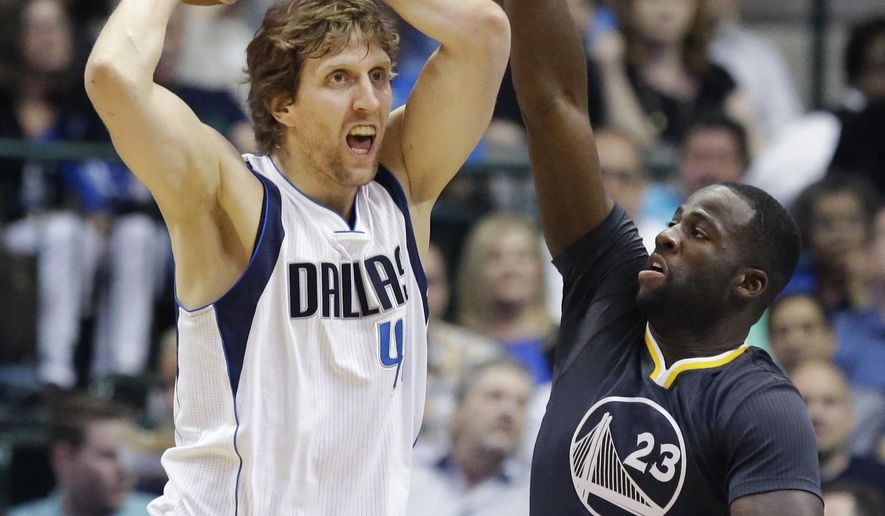 Dallas Mavericks forward Dirk Nowitzki (41) looks to pass against Golden State Warriors forward Draymond Green (23) during the first half of an NBA basketball game, Saturday, April 4, 2015, in Dallas. (AP Photo/LM Otero)