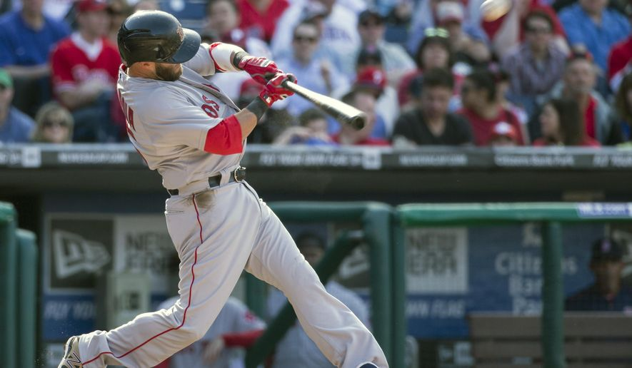 Boston Red Sox second baseman Dustin Pedroia hits his second solo home run during the fifth inning of an opening day baseball game against the Philadelphia Phillies, Monday, April 6, 2015, in Philadelphia. (AP Photo/Chris Szagola)