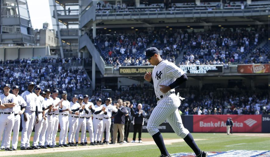 Teammates applaud as New York Yankees designated hitter Alex Rodriguez takes the field during opening day introductions before a baseball game between the Yankees and the Toronto Blue Jays  in New York, Monday, April 6, 2015. (AP Photo/Kathy Willens)