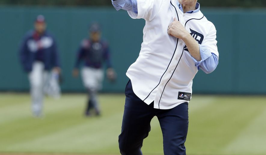 Actor J.K. Simmons throws out the ceremonial first pitch before an opening day baseball game between the Detroit Tigers and the Minnesota Twins in Detroit, Monday, April 6, 2015. (AP Photo/Carlos Osorio)